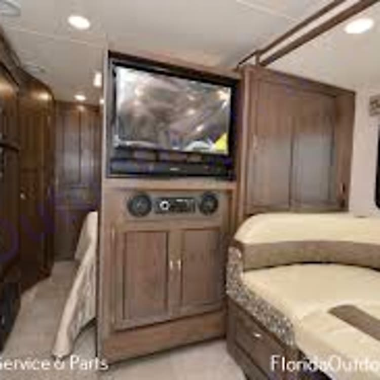 Stereo and TV slide out and pivots to show in the master bedroom or dining area