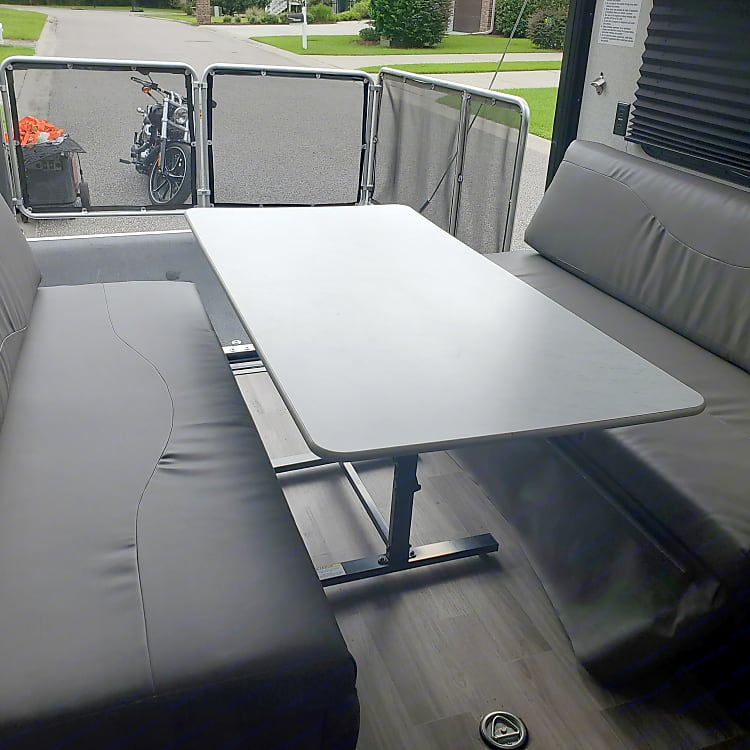 Table converts to 2nd queen size bed