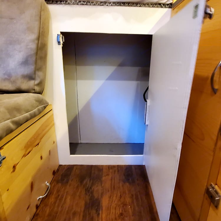 Storage closet. Hooks on top to hang coats/backpacks and a waterproof floor for shoes.