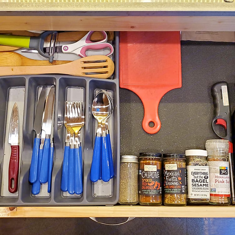 Top sliding drawer includes all utensils as well as basic oil/spices for cooking.