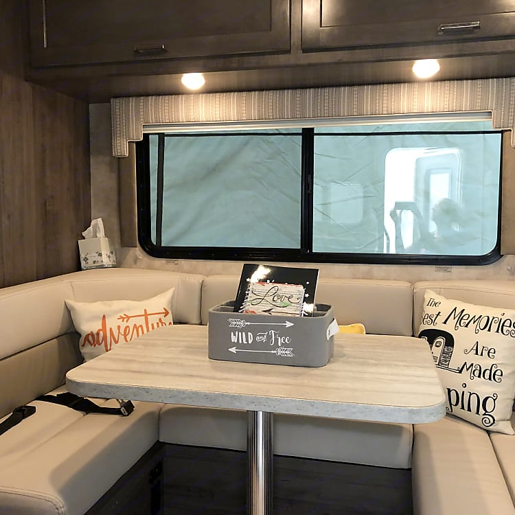 Food storage up above. Seatbelts for added safety when the RV is en route.