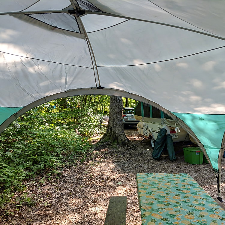 15x15 Coleman tarp included for a dry and shaded experience