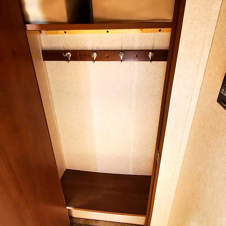 Closet in the rear of the trailer. This in addition to the ample overhead storage makes life easy.
