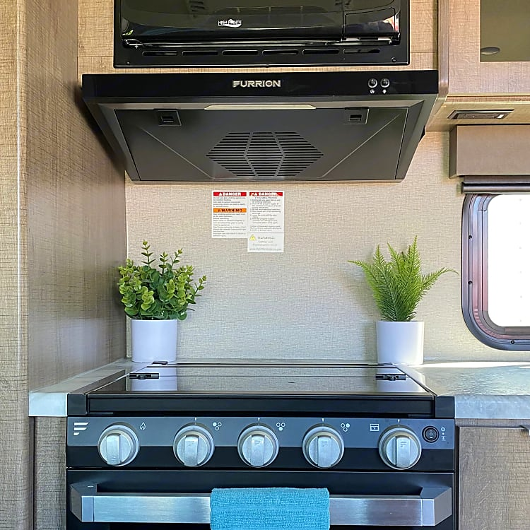 Buzz has all the major (RV size) appliances in the kitchen! Microwave, stove, oven and refrigerator with freezer.