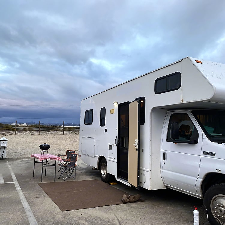 Side of rig. Rental comes with small table and 2 chairs