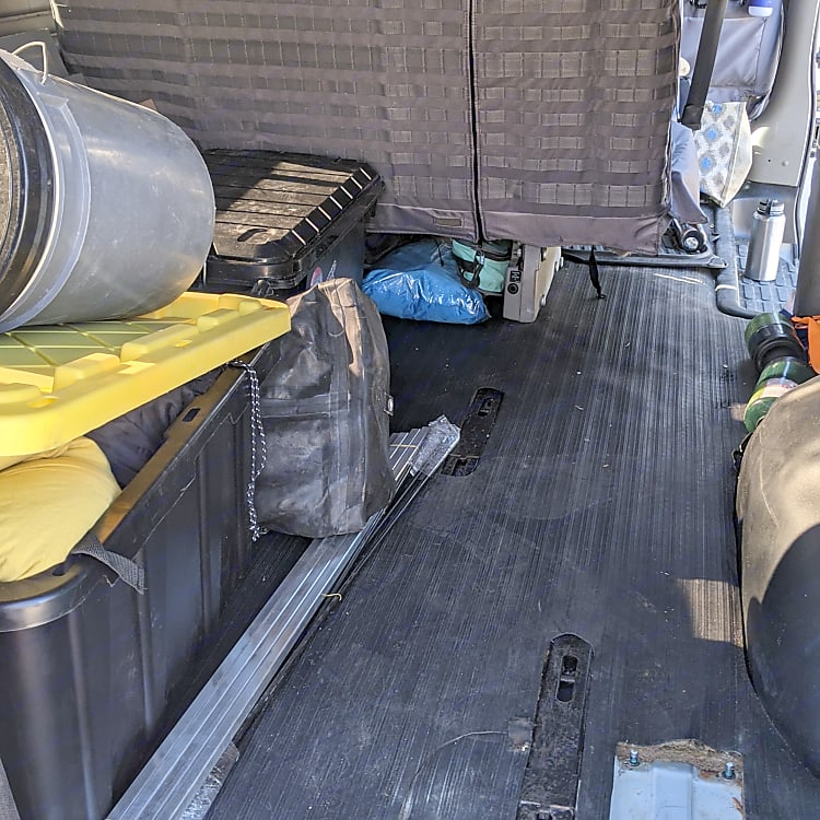 Large storage area behind seat with optional/moveable bed platform