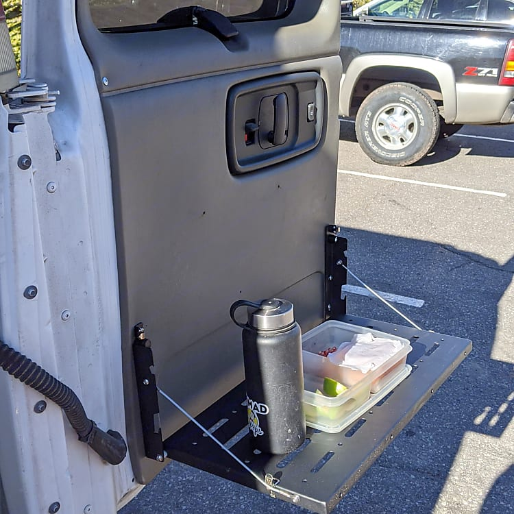 Both rear doors have tables
