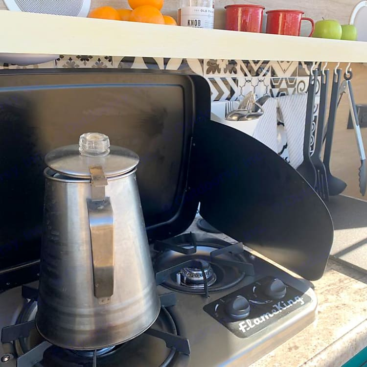 The two gas powered burners make it easy to prepare a meal or brew fresh coffee in the morning.