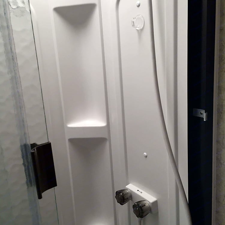 Shower is just enough..fully functional. Well organized for privacy and space.