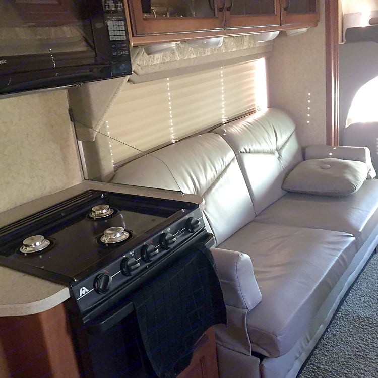 Leather sofa bed, gas stove and burners. Perfect condition.  Oak mirrored storage cabinets. Nicely laid out