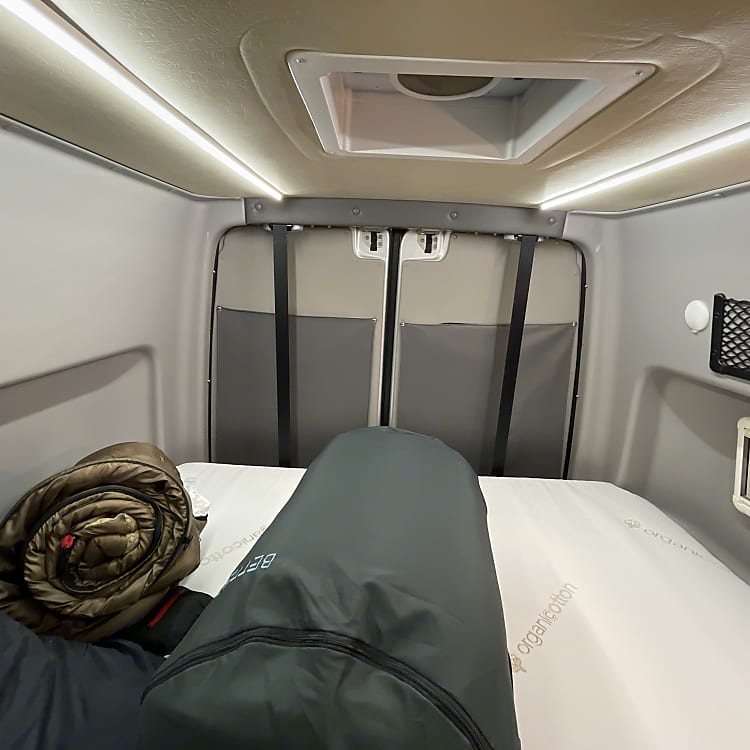 The storage area and sleep zone has a bed that lowers down. It's about a Queen size. And with the van's popouts, you get a full length bed.