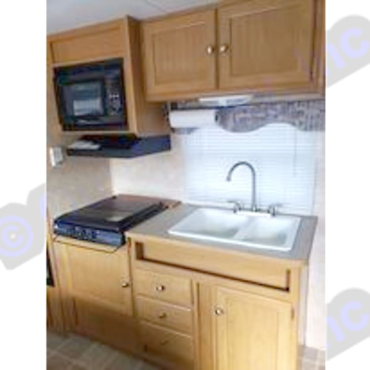 Kitchen sink, stove top, and microwave