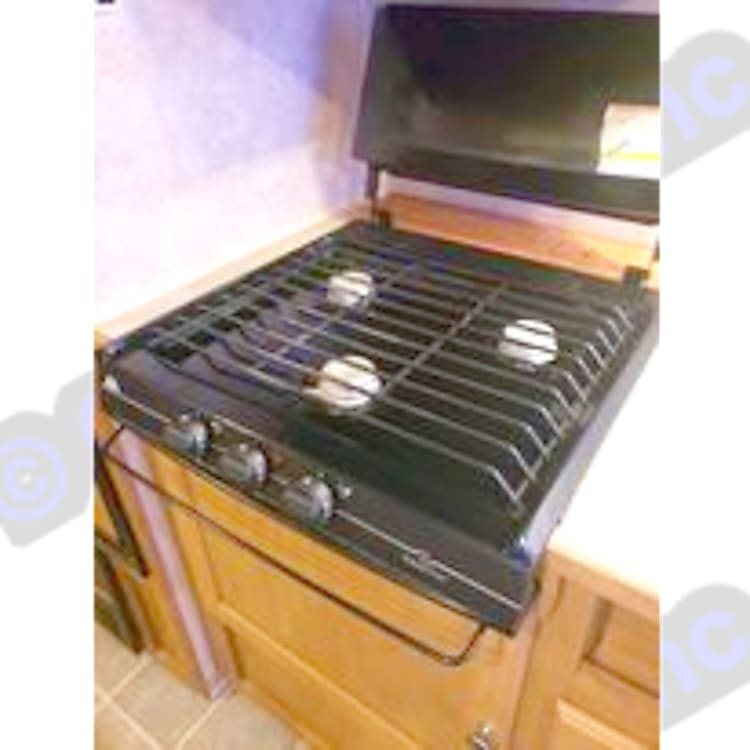 Propane heated stove top with 3 burners