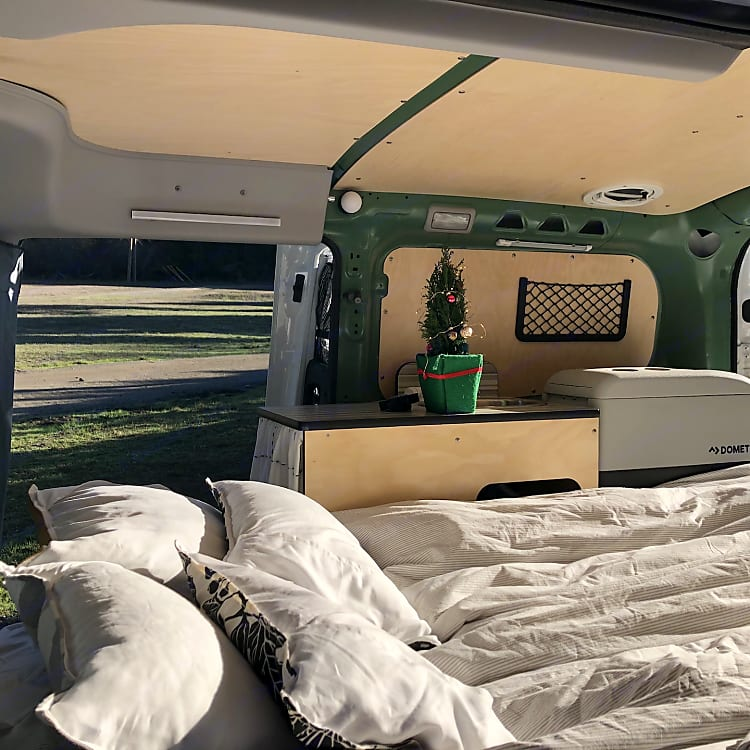 Bench folds out to a bed.  Linens, comforter, and four camping pillows included in rental.