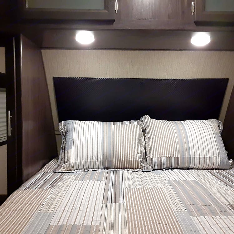 Queen bed, with wardrobe closet on each side as well as overhead cabinets & pocket door for privacy. Separate outdoor entrance into bedroom.