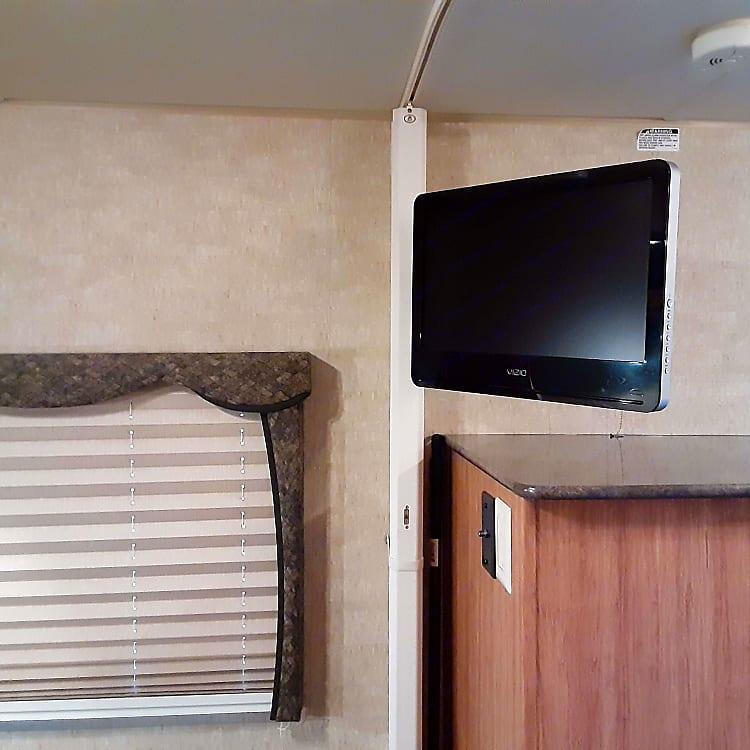 TV in bedroom; Accordion door for privacy.