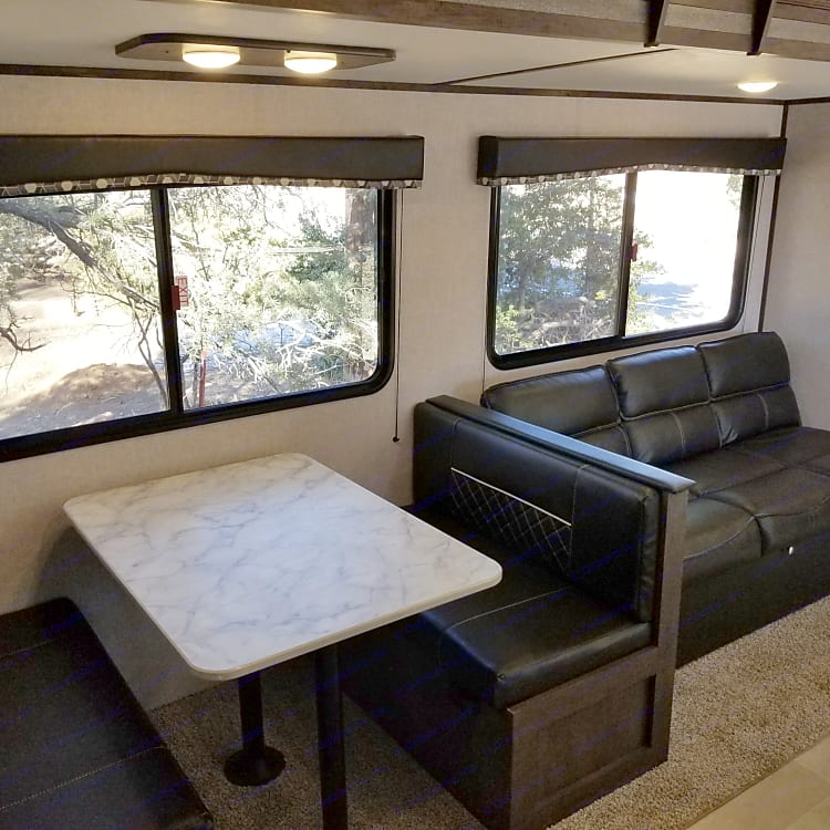 Ample seating with the couch and table area. Both fold out into beds.