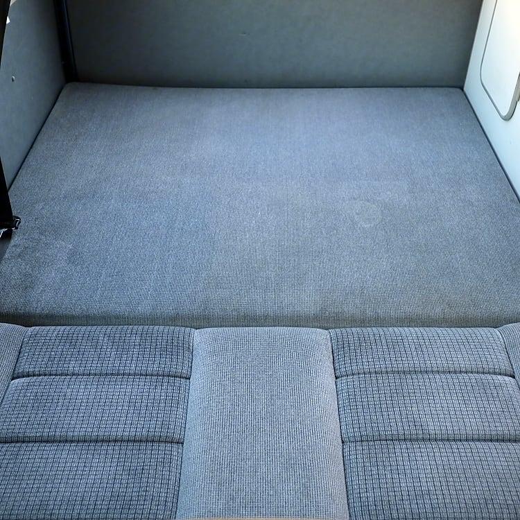 Memory foam mattress topper with clean cover available as add-on.