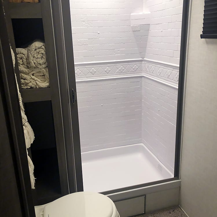 One reason we chose this camper was the head room in the shower for my husband. Nice retractible shower curtain