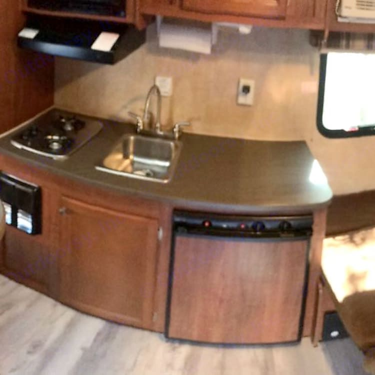 Plenty of work to do your thing in the kitchen. Fridge Sink and cooktop. Microwave too