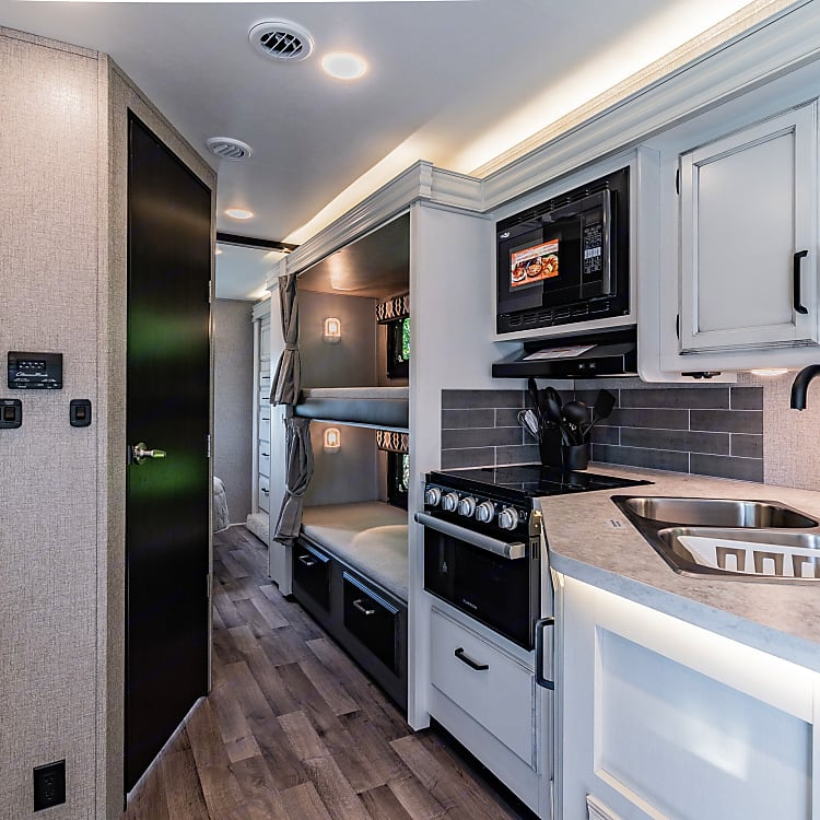 Kitchen has stove, oven, and microwave with convection oven