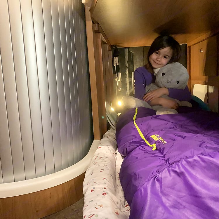 """With a camp pad or two, make a """"hideaway"""" under rear bed. Ideal for splitting up kids who don't want to share a bed. (Technically also fits an adult.)"""