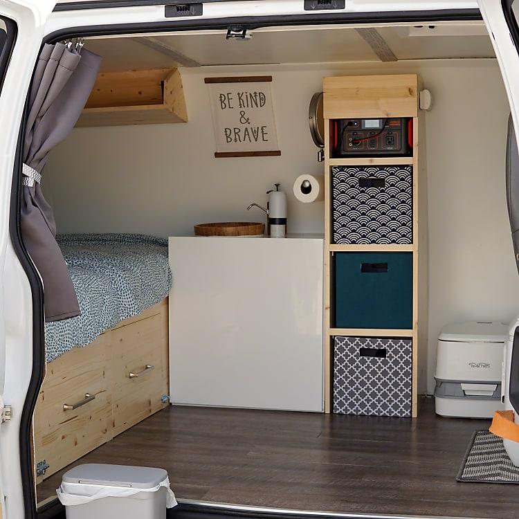 Sink, toilet, storage, drawers all custom built.