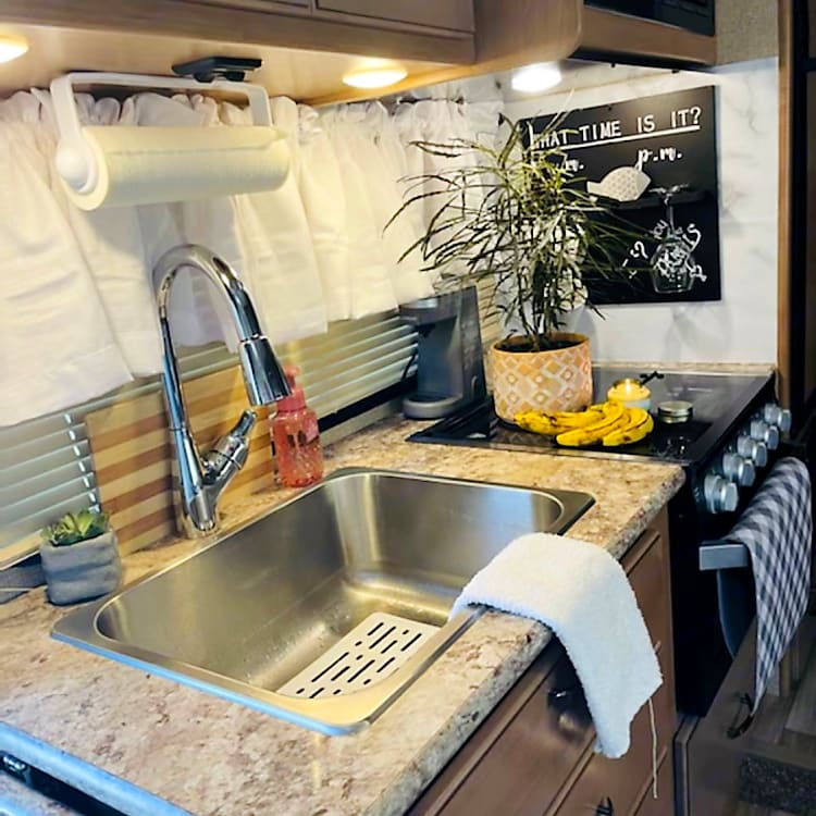Large Stainless Sink, Pull out Faucet Sprayer, drop down counter top adding extra space for the included coffee maker!