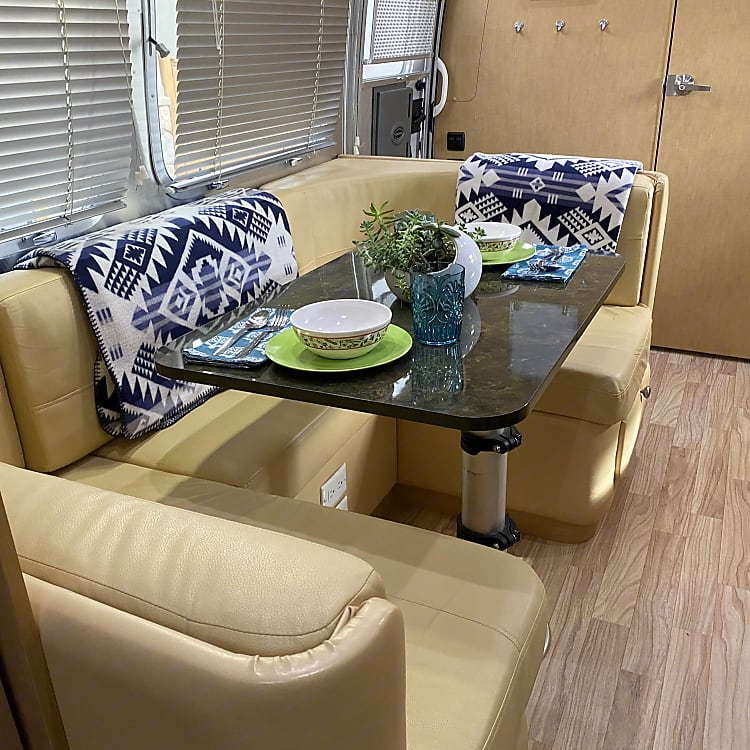 The dinette comfortably seats four adults and can easily be converted to a full bed for one adult or two children.