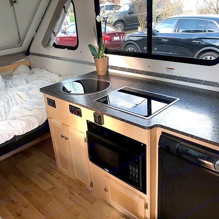sink, gas range, microwave and refrigerator