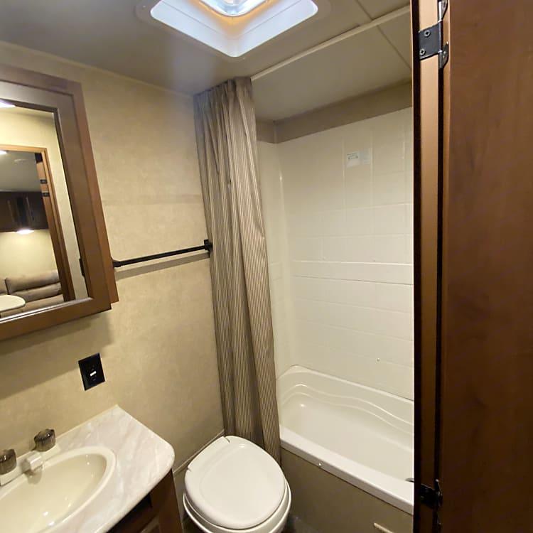 Full size bathroom with toilet, vanity shower/tub combination. Plenty of storage space.