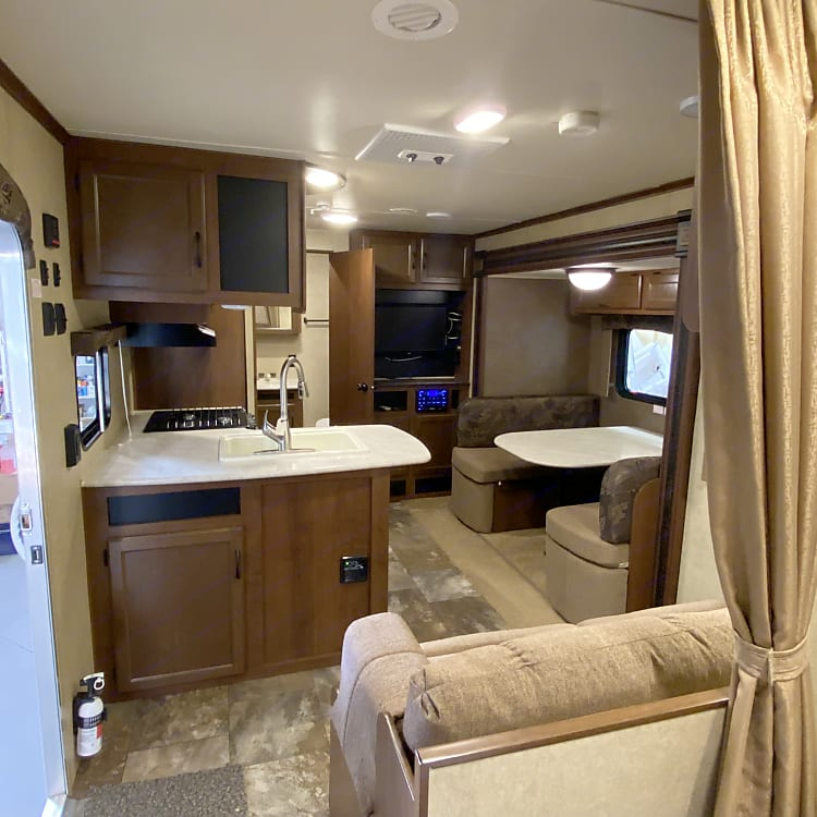 Island view with kitchen and dinette - Dinette folds out to a generous size sleeping area.