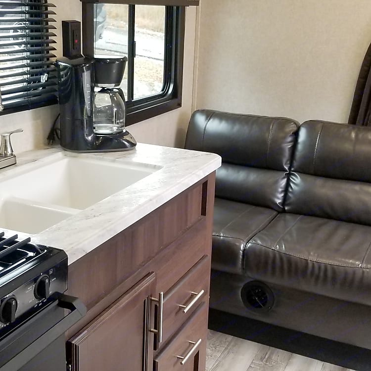 Microwave, 3 burner stove, oven and double sink offers all the conveniences of home