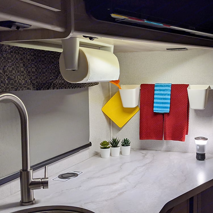 """The kitchen counter can double as a computer """"work station"""". This faucet has the extendable spray feature."""