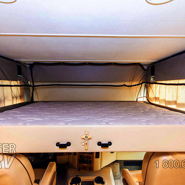 Hidden power bunk bed over the front cab push a button and it lowers down!! has a queen mattress, ladder and 500lb weight capacity.