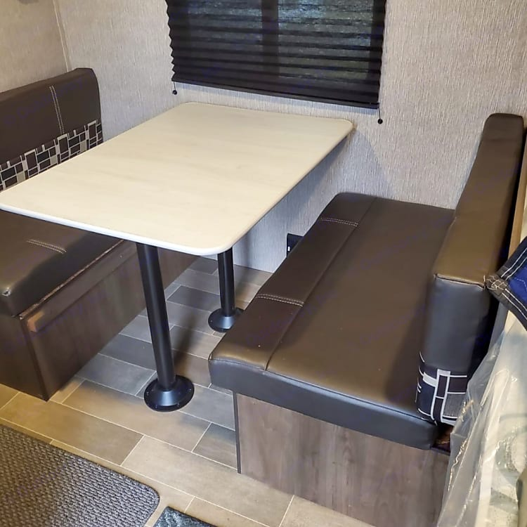 Dining room table that turns in a bed.