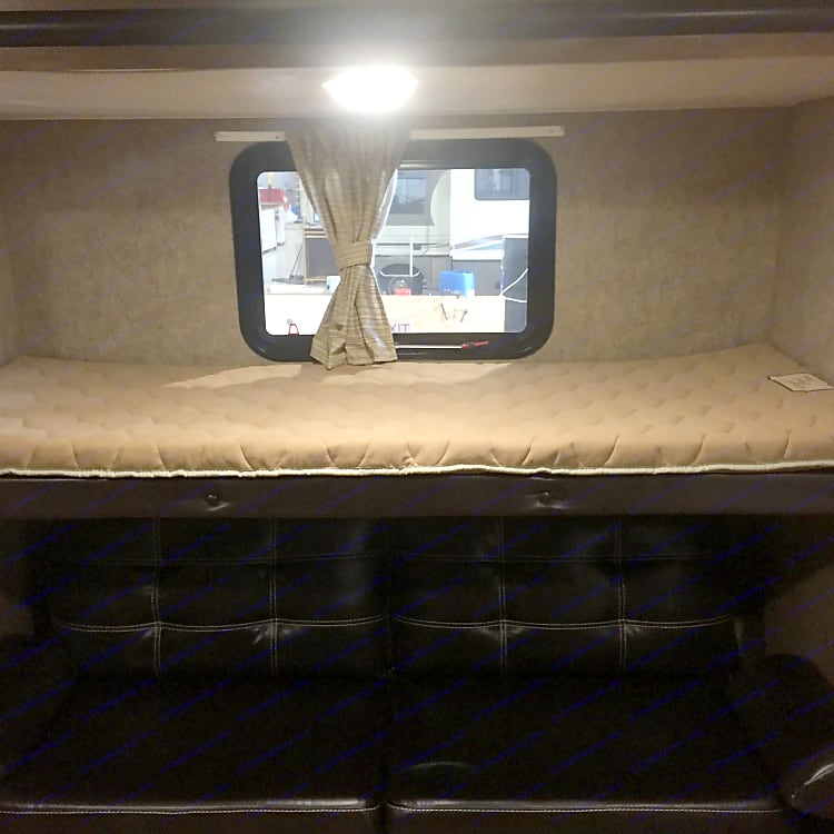 Bunk with fold out sofa below.