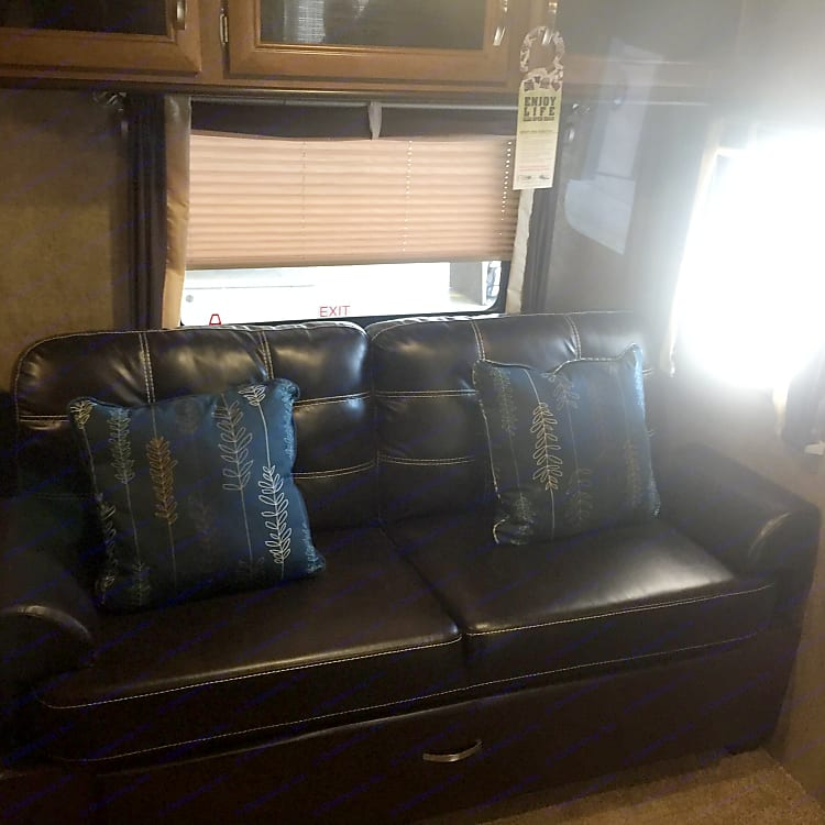 Living room pull out couch with huge  storage drawer under. Identical pull out couch in the bunkroom.