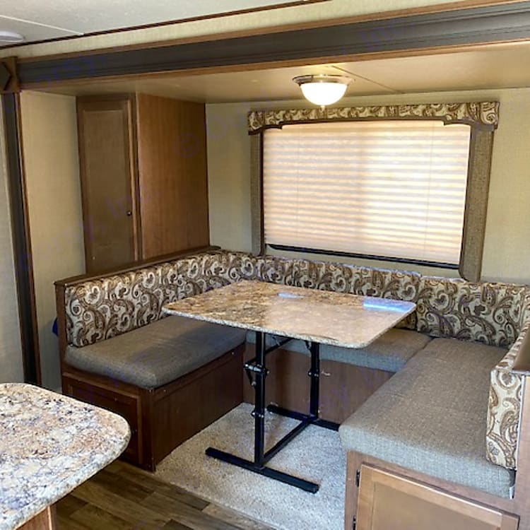 The dining table can sit 6 easily and then folds flat into a queen size bed. there is also storage under the seating area.