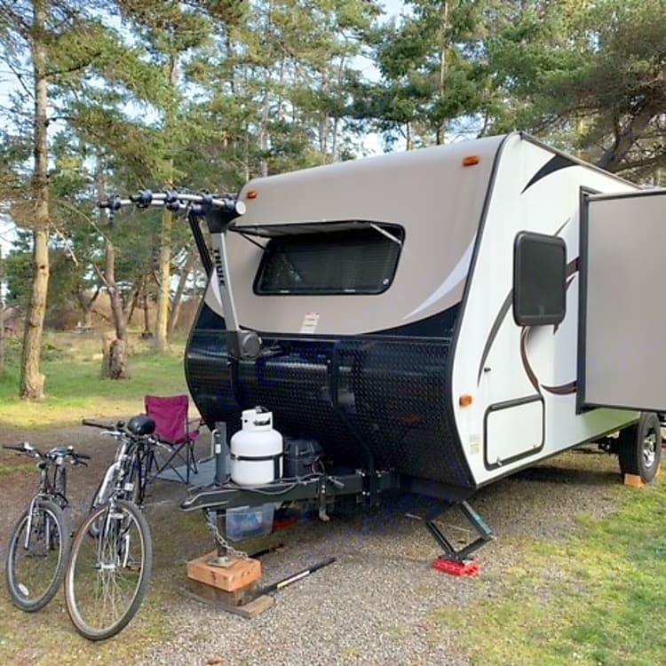 Front window covering raised. Optional bike rack.