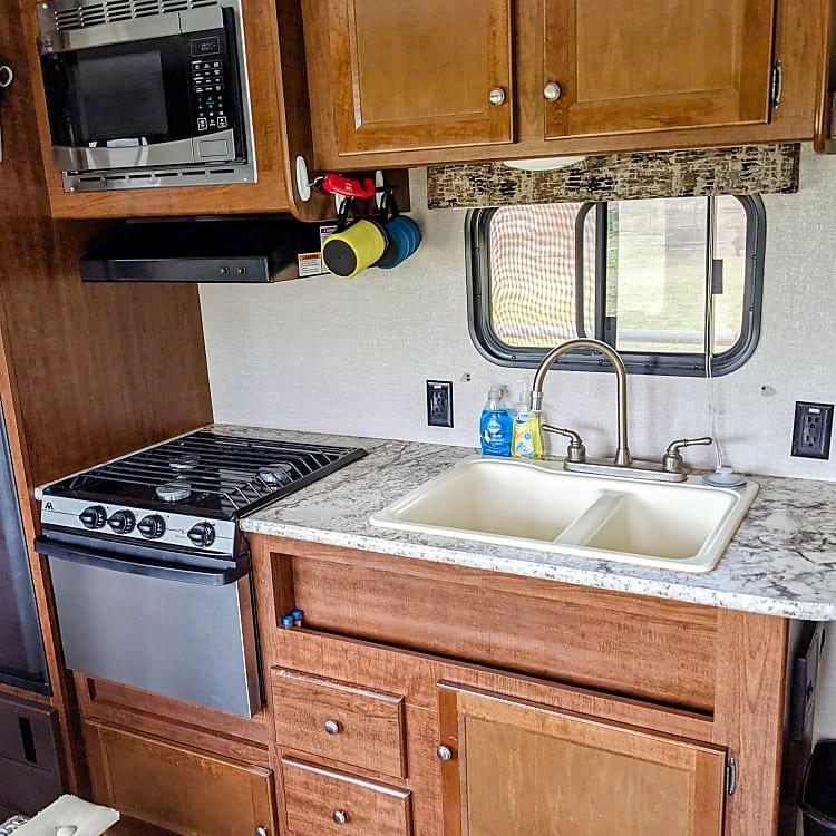 Gas stove (three burners), Microwave, Kitchen sink