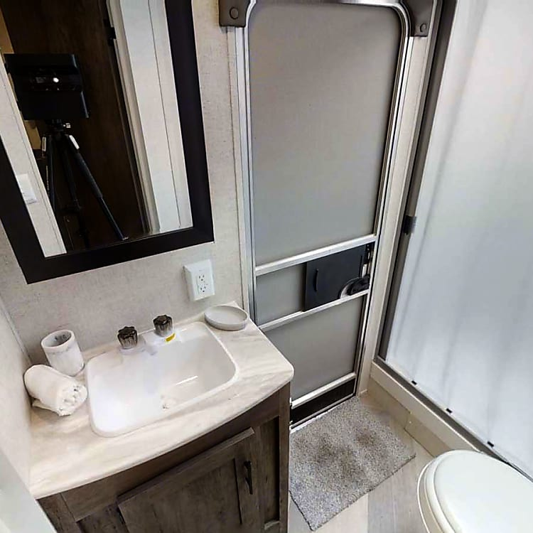 Tub, Shower, toilet, vanity, and separate door to keep wet, muddy feet coming in one entrance!