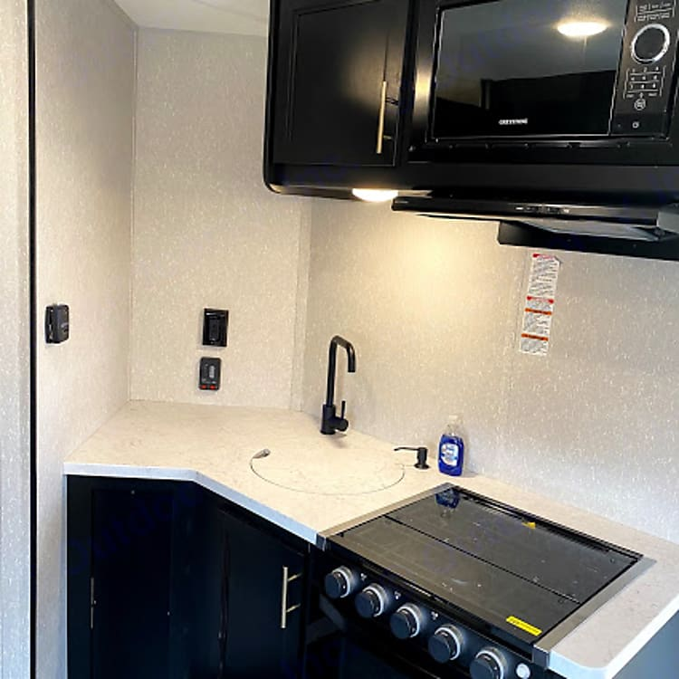 The kitchen has an oversized fridge/freezer, microwave, three-burner stovetop, oven and a sink. We also provide all the basic cooking utensils.