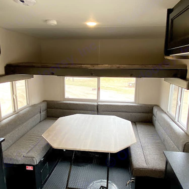 This dinette is great for sitting around and folds down into a long queen-sized bed. The upper bunk is a narrow, but long, full-sized bed.