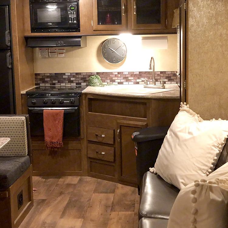 Large fridge, stove, microwave, oven, and plenty of storage.
