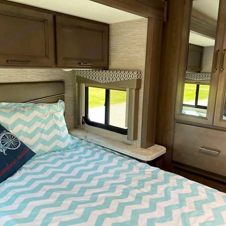 Master queen size bed with walk around room