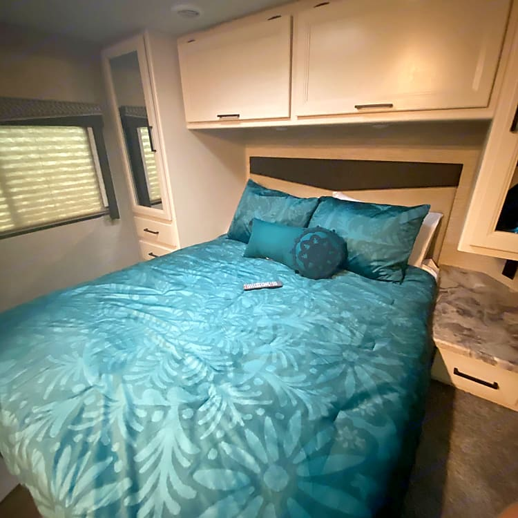 Catch some zzzs in a queen bed topped with a 4 inch memory foam topper - it will be the best sleep you have camping!