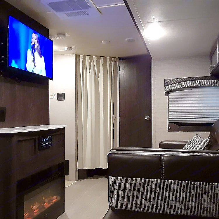 Relax by catching up on the news, watching an evening video, or just enjoying the glow of the electric fireplace, which is great for a chilly morning
