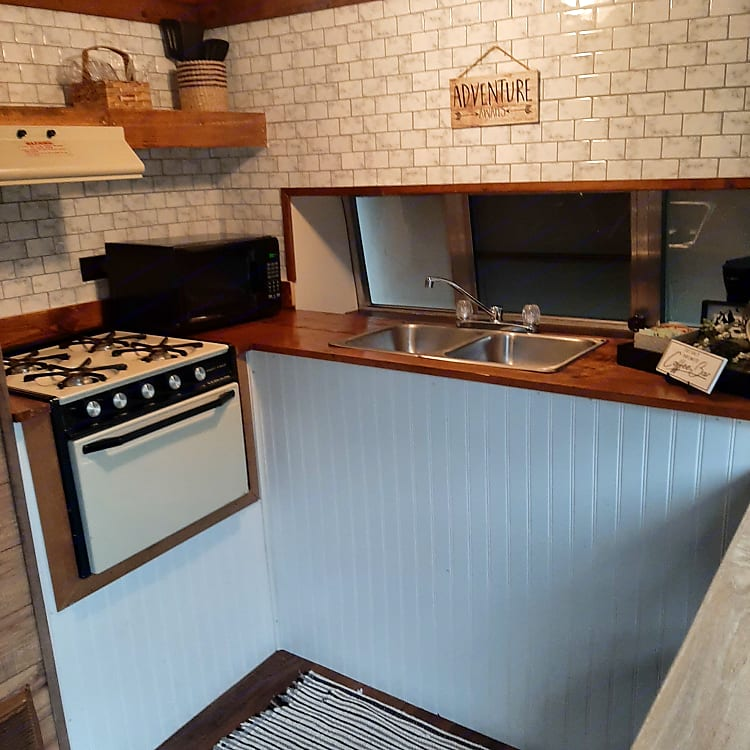 Microwave, stove, electric refrigerator, coffee bar