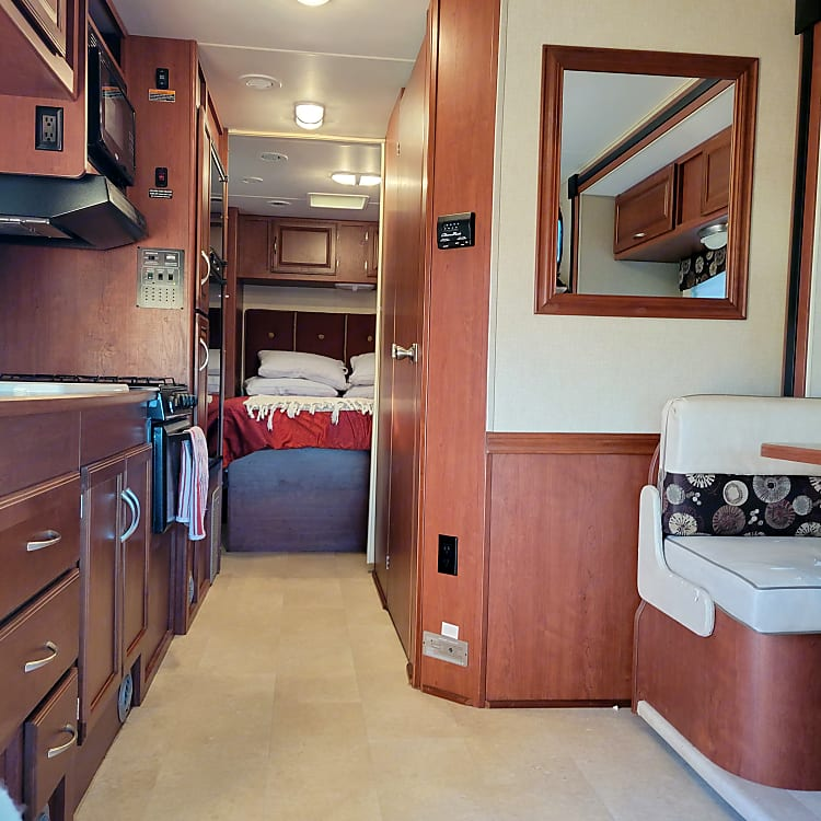 View of the bedroom from the front of the RV.  Dinette has a slide out for additional space.